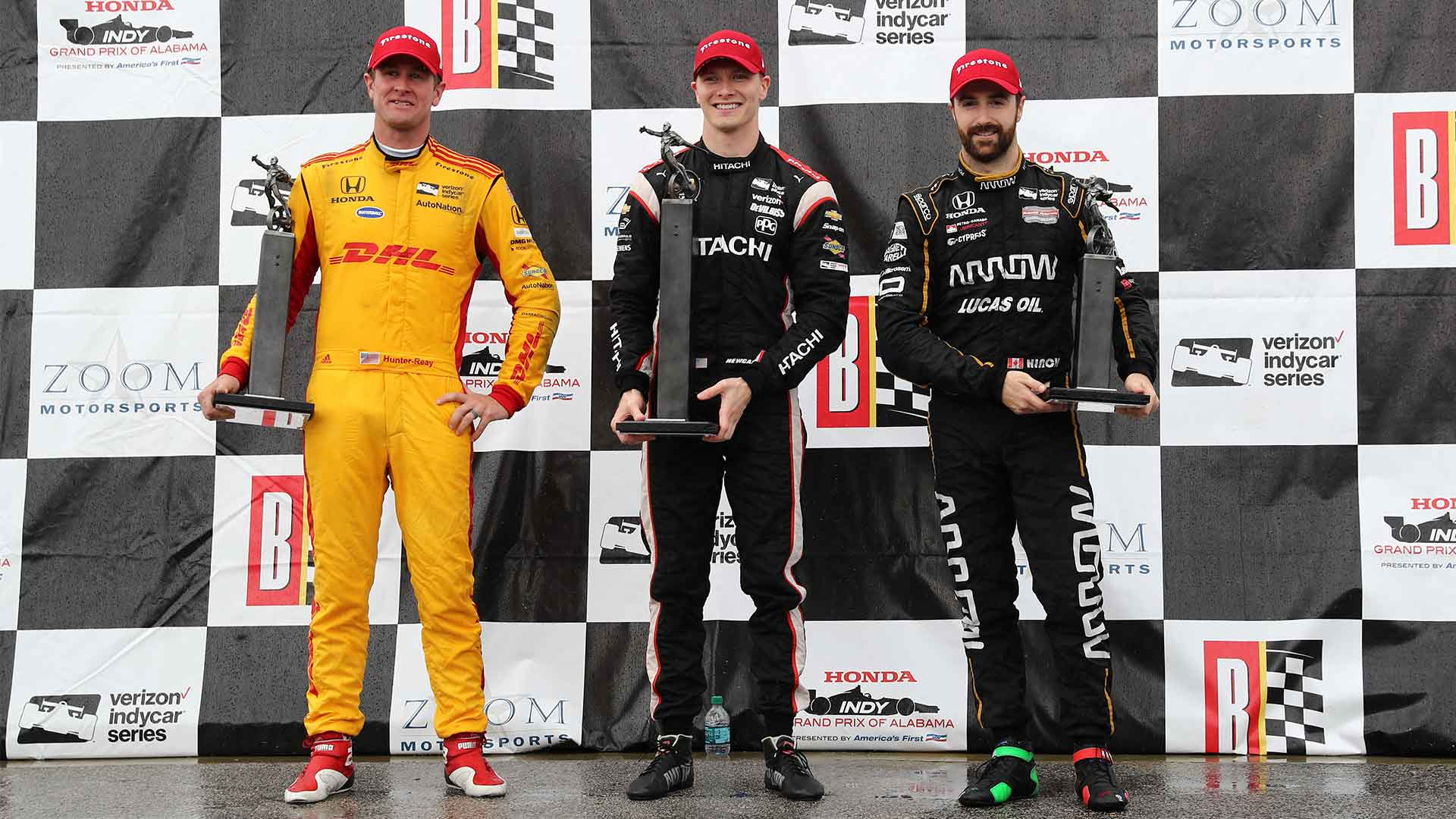 Josef Newgarden, Ryan Hunter-Reay and James Hinchcliffe line up for a podium shoot